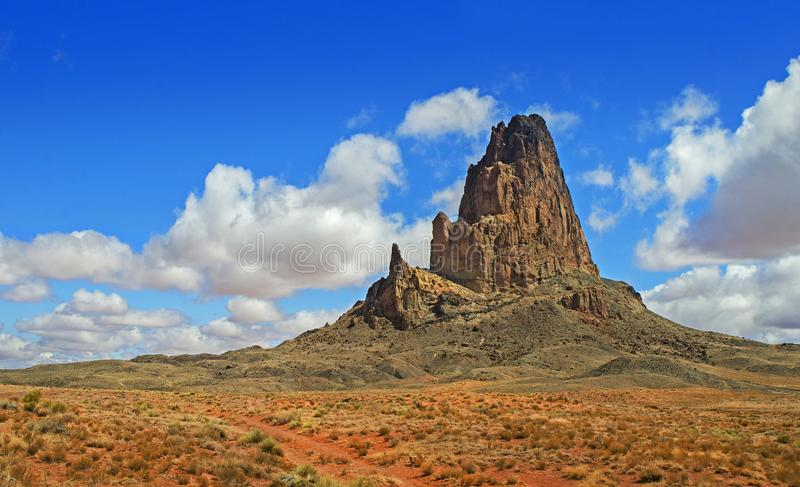 AERIAL VIEW OF AGATHLA PEAK EL CAPITAN IN ARIZONA, USA. DESERT, ROCK, MOUNTAIN, ROAD TO MONUMENT VALLEY. PANORAMA. stock photo