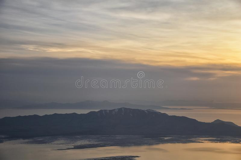 Aerial view from airplane of Antelope Island at sunset, view from Magna, sweeping cloudscape at sunrise with the Great Salt Lake stock image