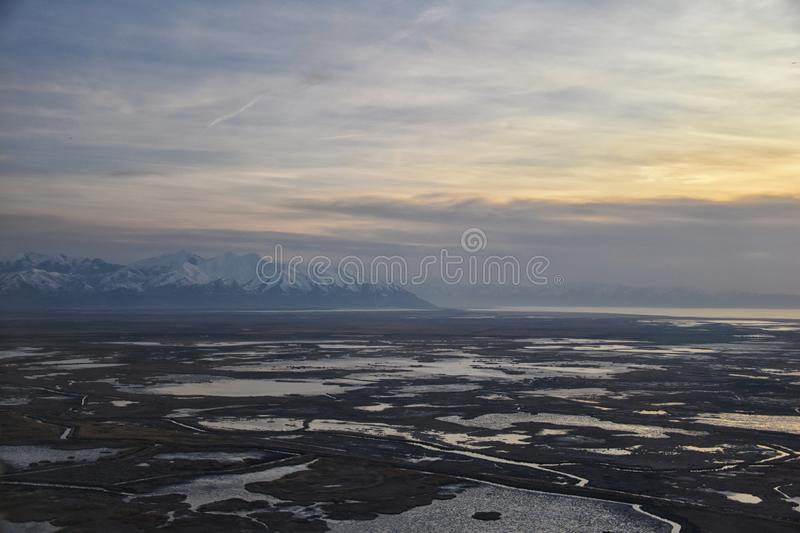 Aerial view from airplane of Antelope Island at sunset, view from Magna, sweeping cloudscape at sunrise with the Great Salt Lake royalty free stock photos