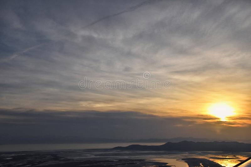 Aerial view from airplane of Antelope Island at sunset, view from Magna, sweeping cloudscape at sunrise with the Great Salt Lake royalty free stock photo