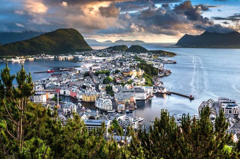 Aerial View of Alesund Center at Beautiful Sunset. Image of Alesund at beautiful sunset in Summer taken from Mount Aksla Viewpoint. Alesund is a port town on the stock photos