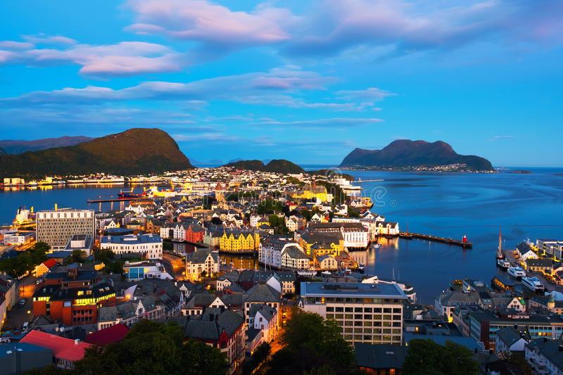 Aerial view of Alesund, Norway at sunset. Blue night sky. Alesund, Norway. Aerial view of Alesund, Norway at sunset. Blue night sky over famous touristic royalty free stock photo
