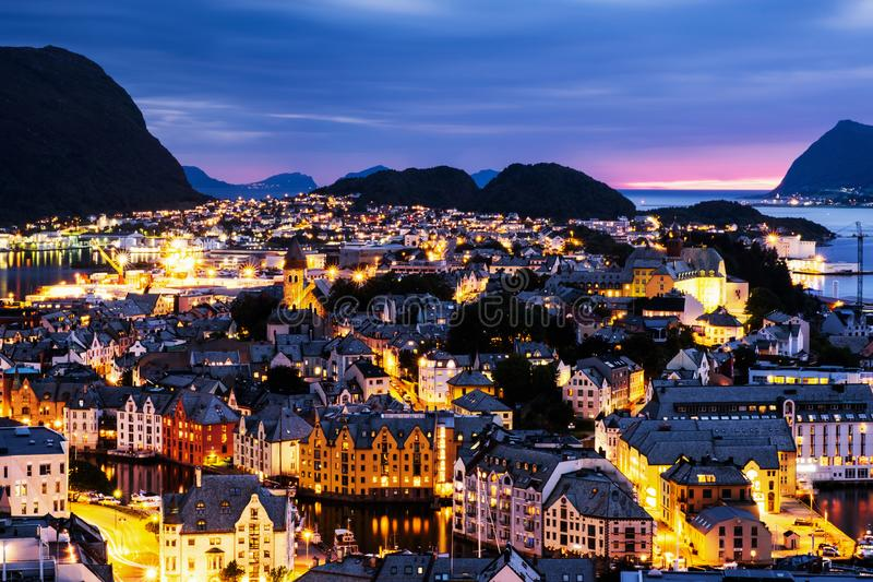 Aerial view of Alesund, Norway at sunset. Blue night sky over famous. Alesund, Norway. Aerial view of Alesund, Norway at sunset. Blue night sky over famous stock images