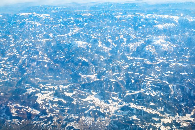 aerial view of Alps mountain from airplane royalty free stock photo