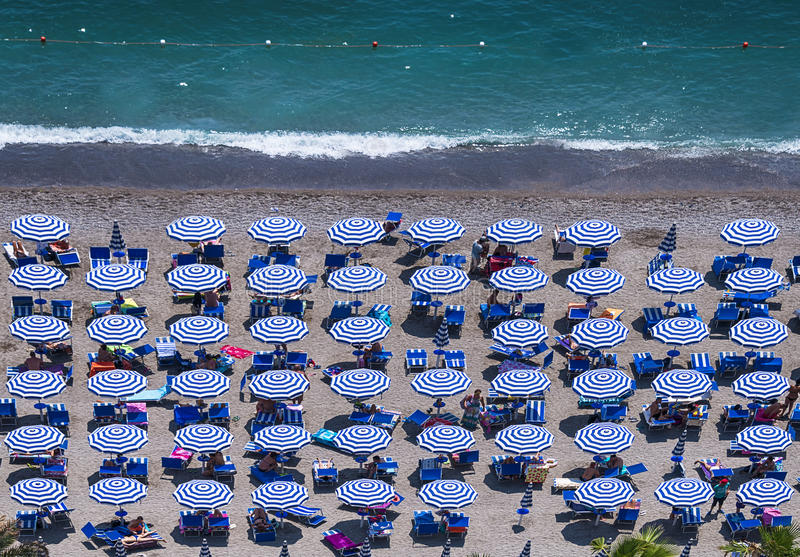 Aerial view of the amazing beach with colorful umbrellas and people who sunbathe royalty free stock photo