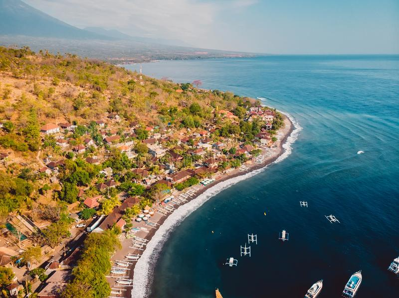 Aerial view of Amed village with sea and boats, Bali stock image