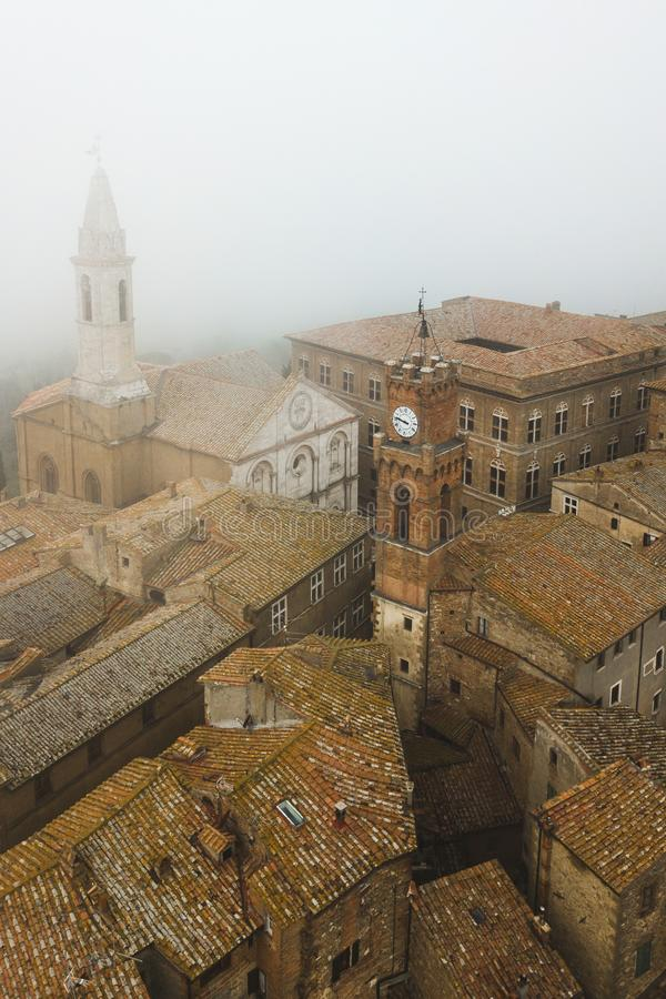 Aerial view ancient italian town Pienza in Tuscany. Aerial view of ancient italian town Pienza in Tuscany. Tile brown roofs, old town hall, narrow streets and royalty free stock photography