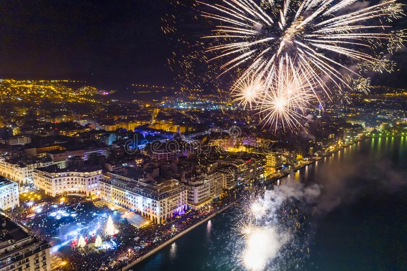 Aerial view of Aristotelous square in Thessaloniki during New Year celebrations with fantastic multi-colored fireworks royalty free stock photo