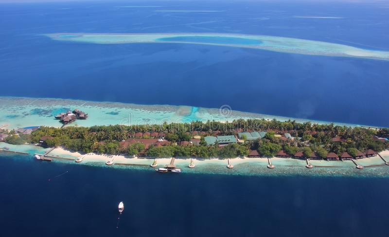 Aerial view of atolls and resort in the Maldives. Aerial view of atolls and a resort in the Maldives. Ari Atoll royalty free stock photo
