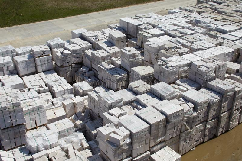 Aerial view of autoclaved aerated concrete blocks, both defective and good, on pallets, stored at factory warehouse.  royalty free stock photo