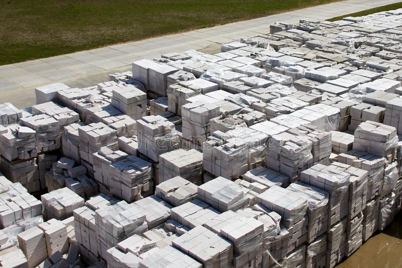Aerial view of autoclaved aerated concrete blocks, both defective and good, on pallets, stored at factory warehouse.  royalty free stock photography