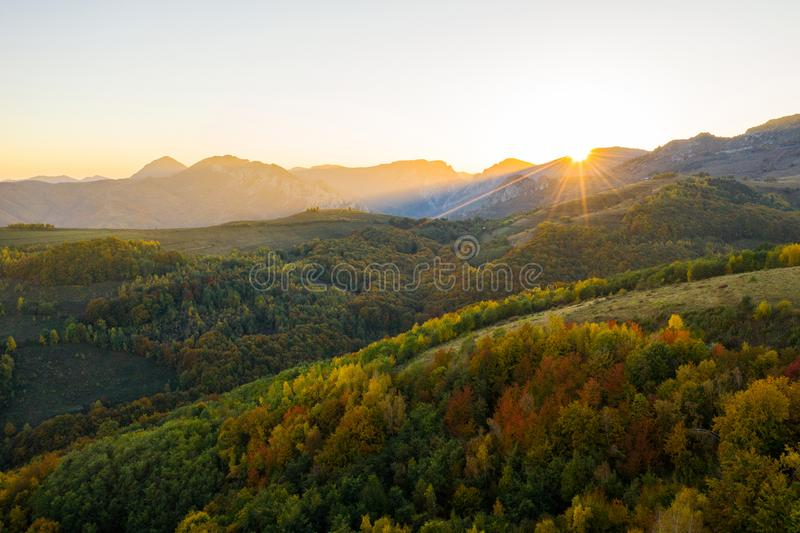 Aerial view of autumn forest in sunset lights. Aerial drone view of autumn forest in sunset lights royalty free stock photo