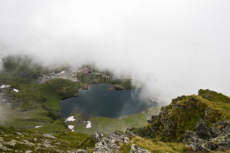 Balea lake in Romania`s Fagaras mountains royalty free stock images