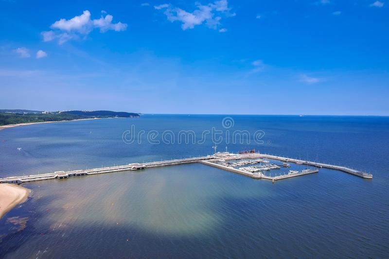 Aerial view for the Baltic sea coastline with wooden pier in Sopot, Poland. Beach, vacation, molo, tourist, water, travel, promenade, europe, landmark, seaside royalty free stock photos