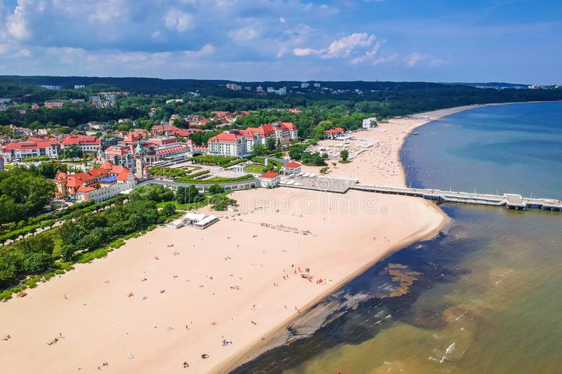 Aerial view for the Baltic sea coastline with wooden pier in Sopot, Poland. Beach, vacation, molo, tourist, water, travel, promenade, europe, landmark, seaside stock photo