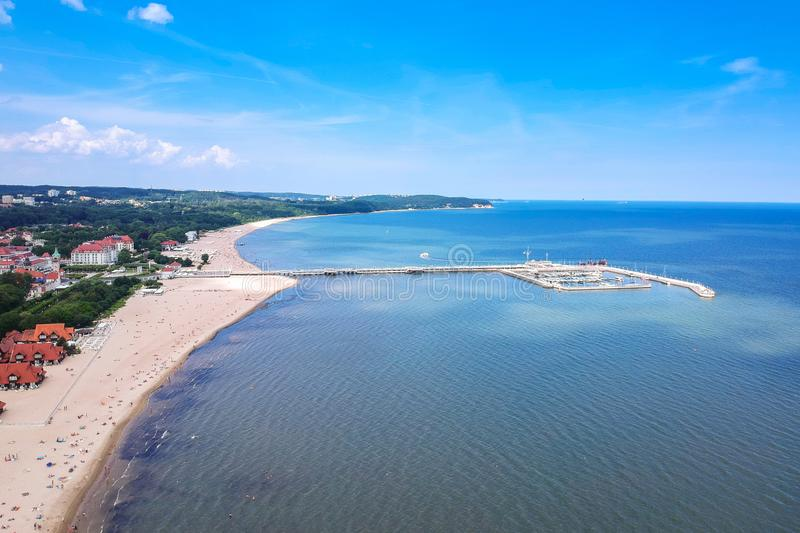 Aerial view for the Baltic sea coastline with wooden pier in Sopot, Poland. Beach, vacation, molo, tourist, water, travel, promenade, europe, landmark, seaside stock image