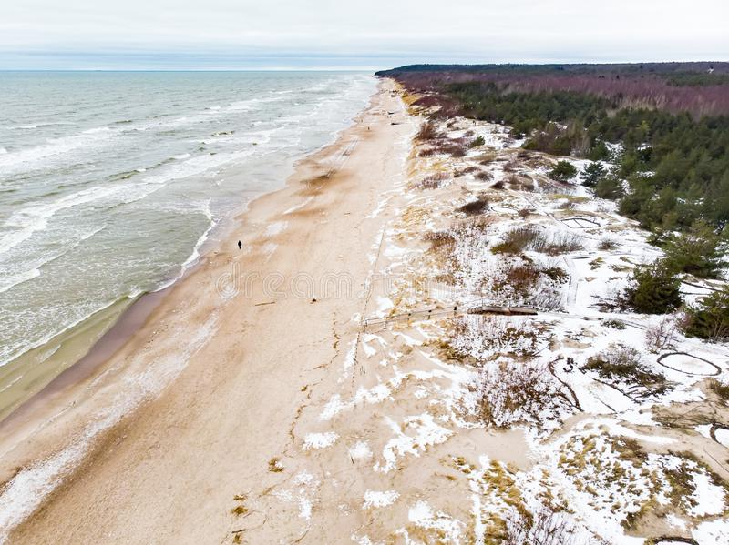 Aerial view of the Baltic Sea shore line near Klaipeda city, Lithuania. Beautiful sea coast on chilly winter day royalty free stock photos