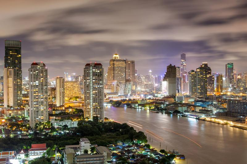 Aerial view of Bangkok modern office buildings, Condominium in Bangkok city downtown with night scene stock photos