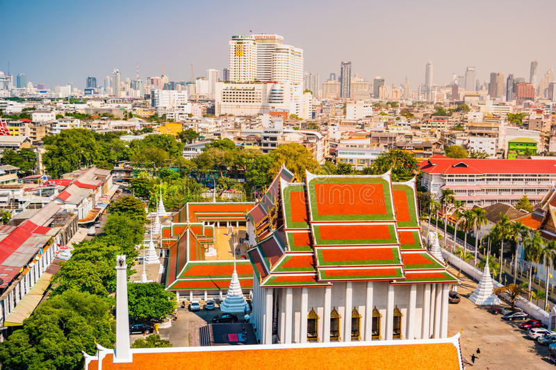 Aerial view of Bangkok monastery and modern office buildings royalty free stock photo