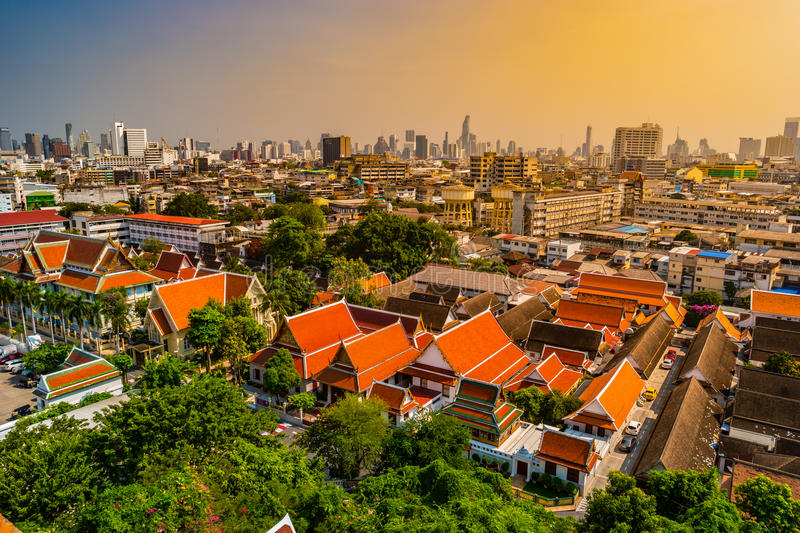 Aerial view of Bangkok monastery and modern office buildings stock images