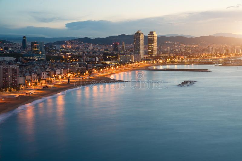Aerial view of Barcelona Beach in summer night along seaside in stock images