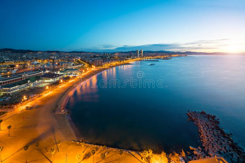 Aerial view of Barcelona Beach in summer night along seaside in royalty free stock images