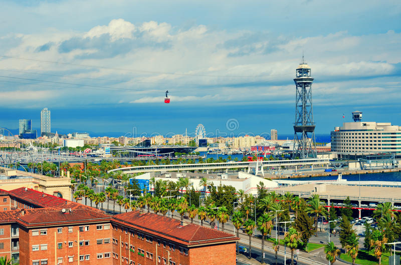 Aerial view of Barcelona. La Barceloneta, Port Vell, sea and red cabin of the cableway. Catalonia, Spain royalty free stock images