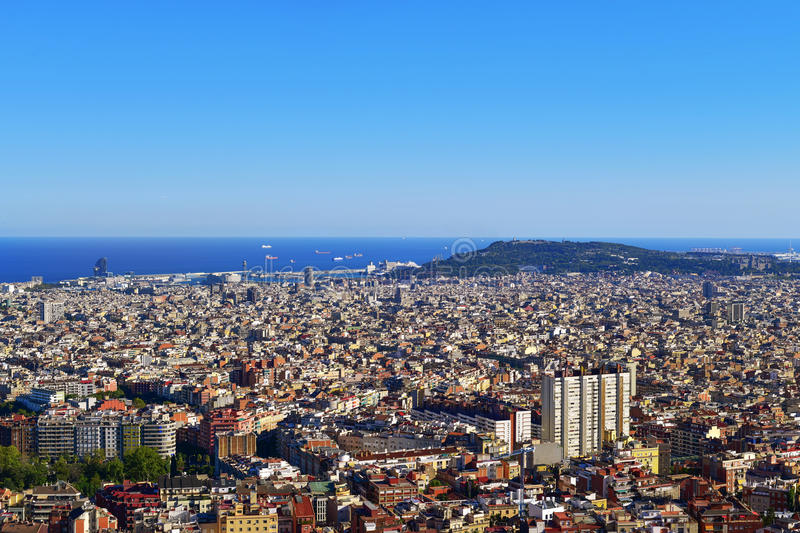 Aerial view of Barcelona, Spain. An aerial view of Barcelona, Spain, seen from the Turo de la Rovira hill, with the Montjuic Hill highlighting to the right, and royalty free stock images