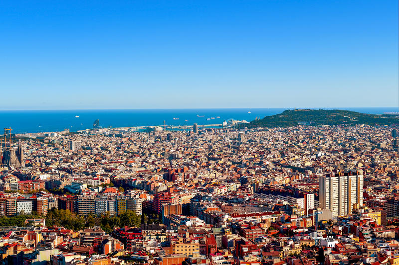 Aerial view of Barcelona, Spain. An aerial view of Barcelona, Spain, seen from the Turo de la Rovira hill, with the Montjuic Hill highlithing to the right, and royalty free stock image