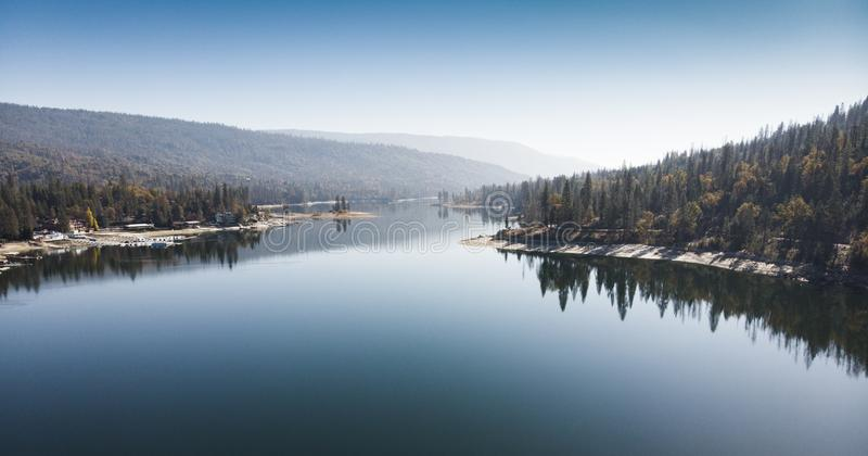 Aerial view of Bass Lake with reflection of forest in the clear water royalty free stock photos
