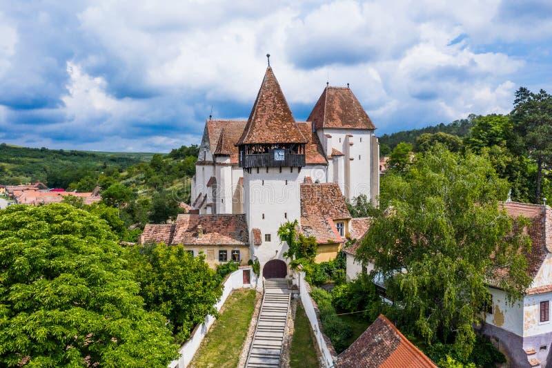 Bazna, Romania. Aerial view of Bazna fortified church. Saxon landmark in Transylvania, Romania royalty free stock image