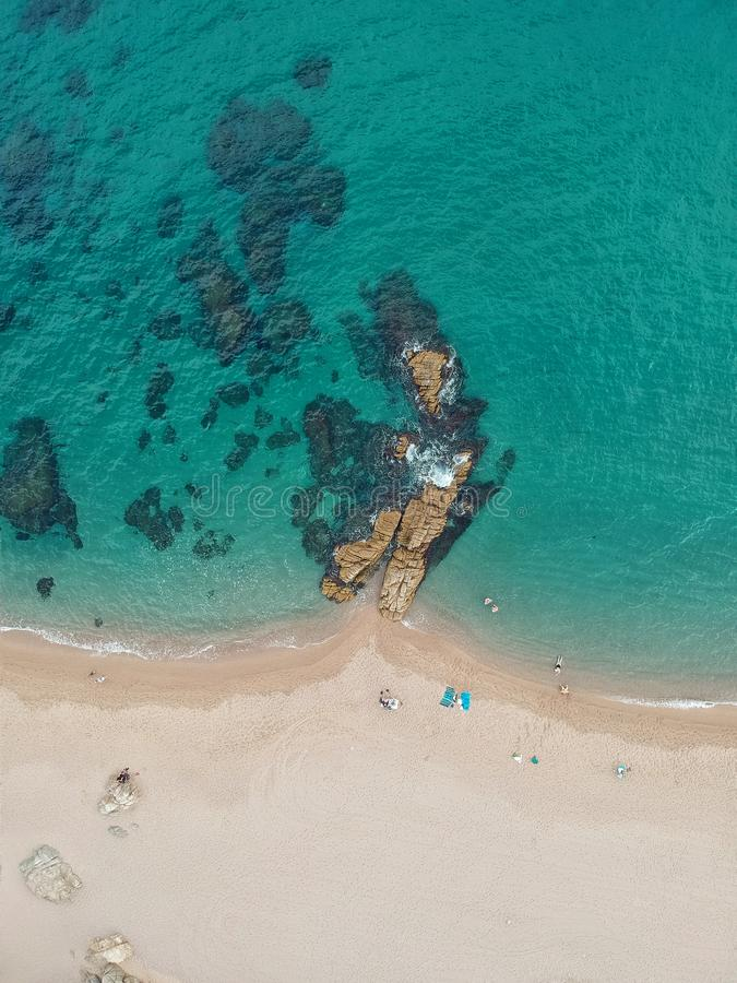 Aerial view of beach with cliff and sea in Costa Brava royalty free stock photography
