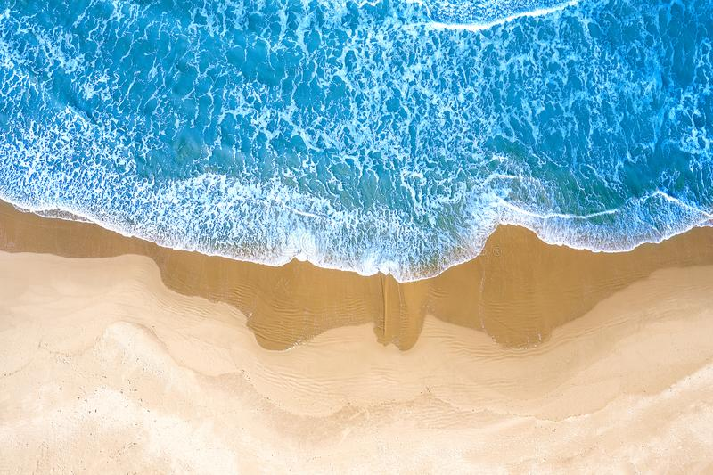 Blue sea at the beach seen from above royalty free stock images