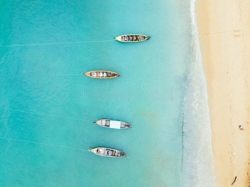 Aerial view of beach with four boats stock images