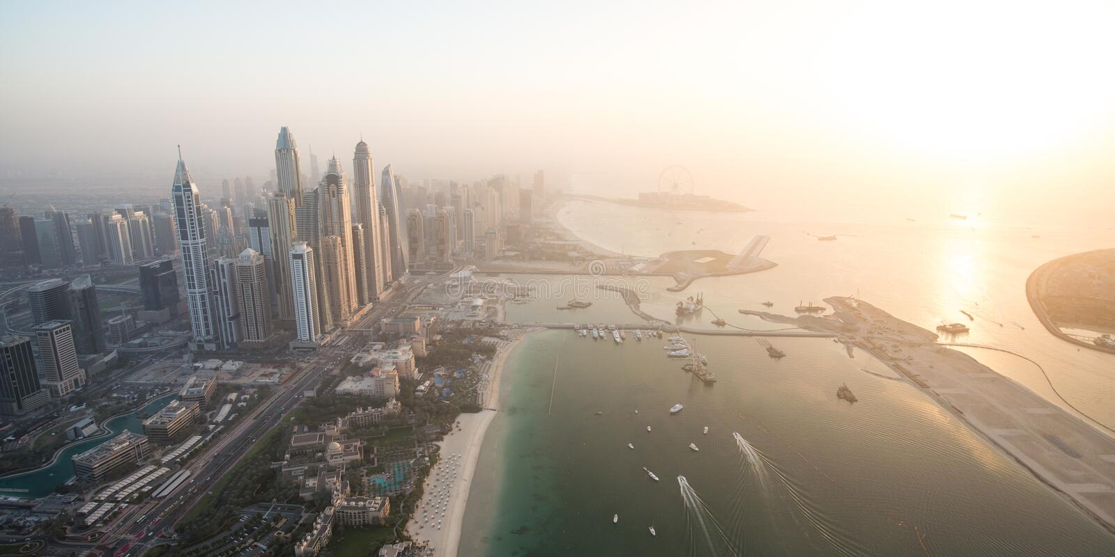 Aerial view of beach at Jumeirah Beach Residence (JBR) during sunset in Dubai, UAE royalty free stock photography