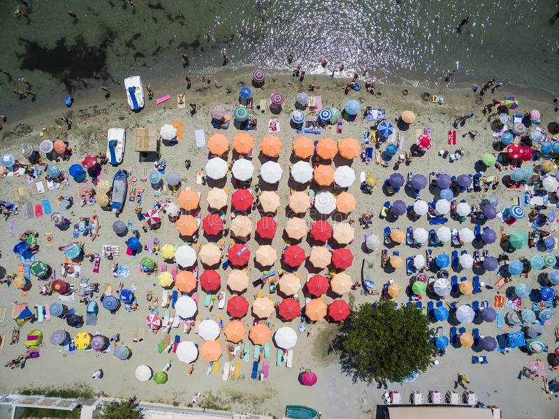 Aerial view of beach in Katerini, Greece. Aerial view of the beach of Katerini in Greece. colorful umbrellas and people who swims. Aerial shot stock photos