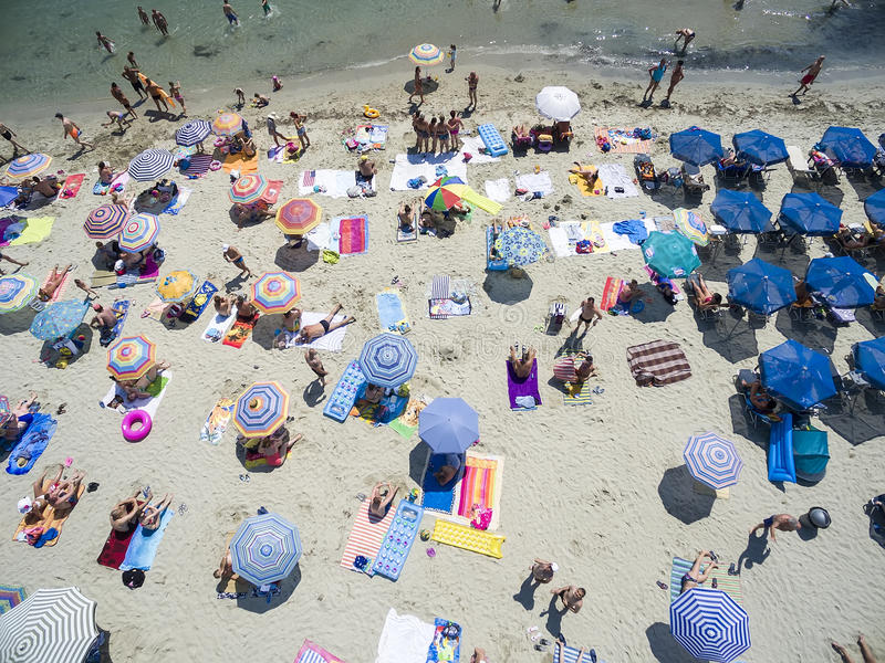 Aerial view of beach in Katerini, Greece. KATERINI, GREECE, JULY 5 2015: Aerial view of the beach of Katerini in Greece. colorful umbrellas and people who swims royalty free stock photography