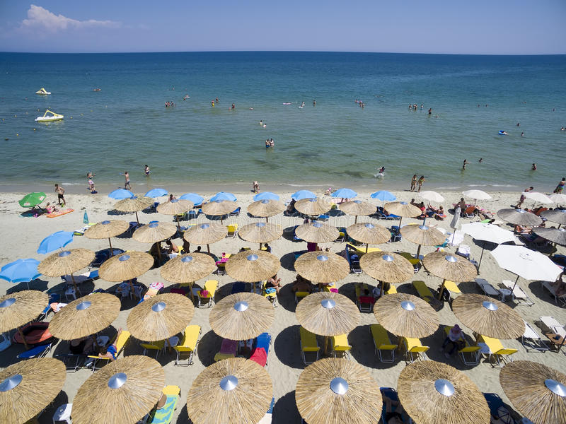 Aerial view of beach in Katerini, Greece. KATERINI, GREECE, JULY 5 2015: Aerial view of the beach of Katerini in Greece. colorful umbrellas and people who swims stock photos