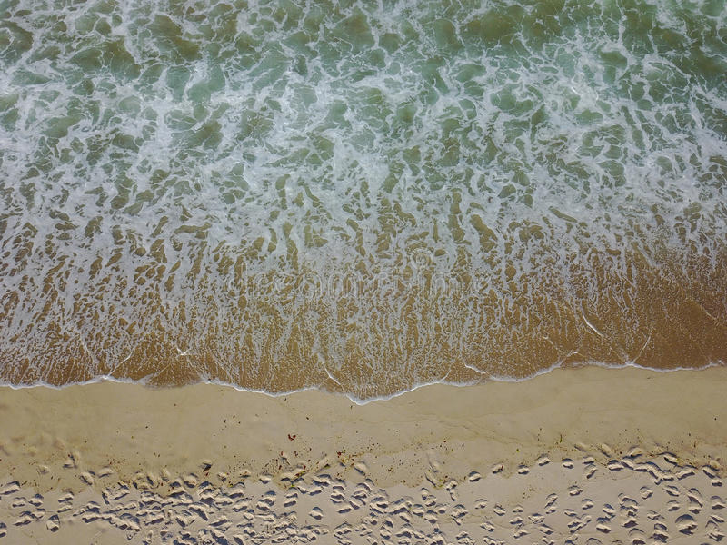Aerial View of Beach and Ocean on Cape Cod, Massachusetts. Waves from the Atlantic Ocean wash onto a scenic beach on Cape Cod, Massachusetts. This sandy royalty free stock images