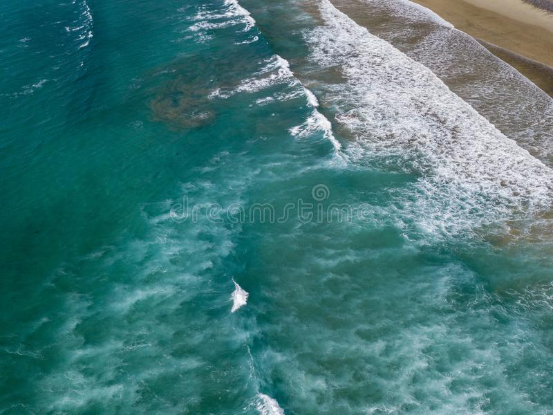 Aerial view of a beach, shore, waves crashing on the coast. Famara Beach. Lanzarote, Spain stock images