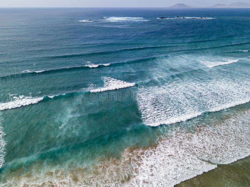 Aerial view of a beach, shore, waves crashing on the coast. Famara Beach. Lanzarote, Spain royalty free stock images