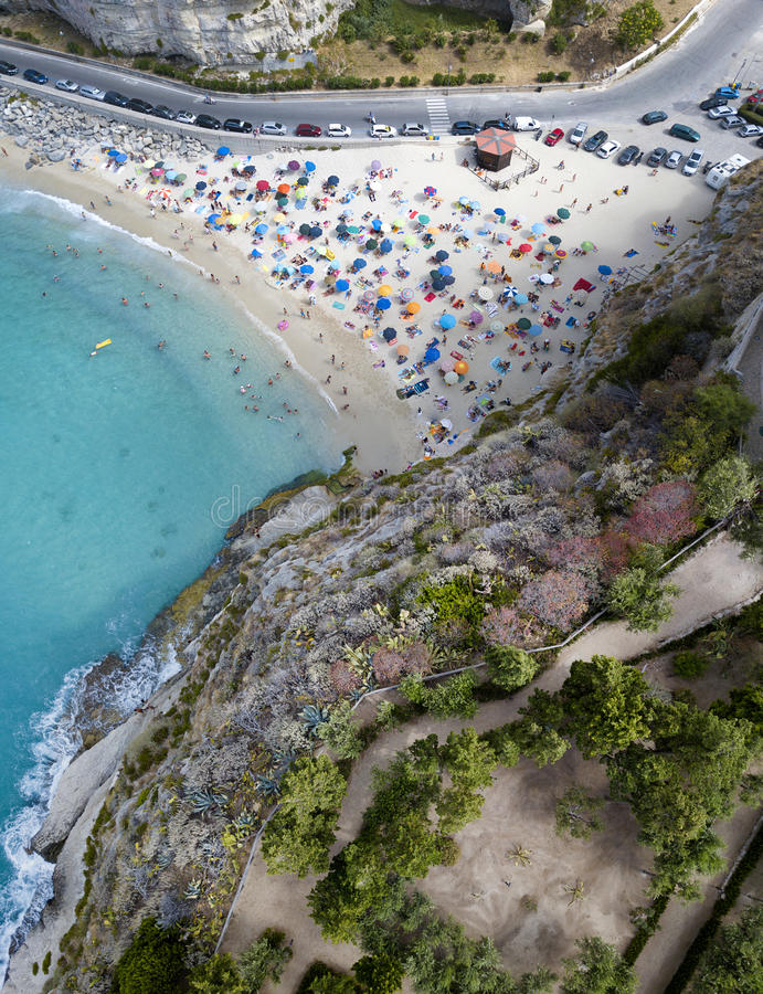 Aerial view of a beach with umbrellas and bathers. Tropea, Calabria, Italy. Aerial view of a beach with umbrellas and bathers. Promontory of the Sanctuary of royalty free stock photography
