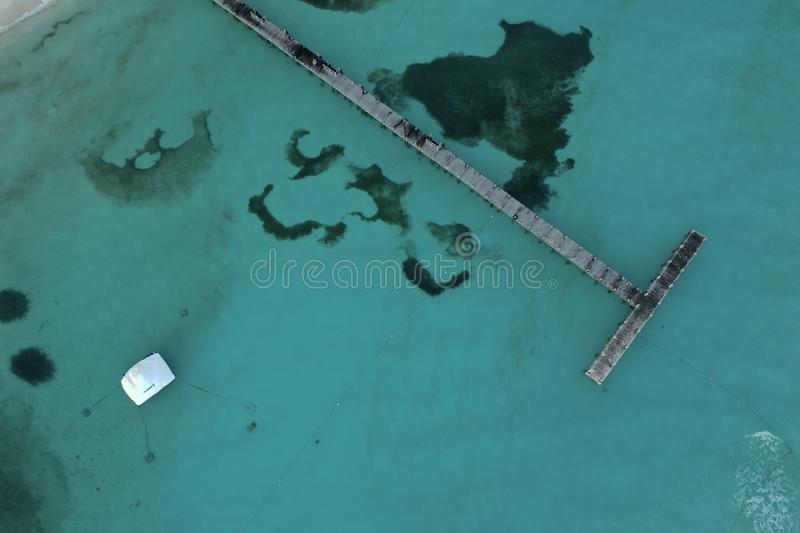Aerial view of beautiful Coral beach in Cancun Mexico. Drone perspective of the beautiful turquoise waters at Coral beach in Cancun, Mexico royalty free stock photo