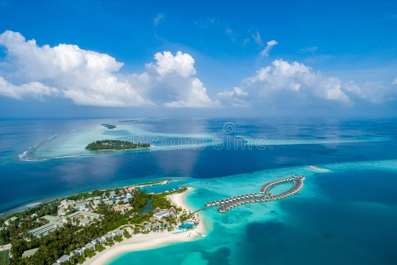 Aerial view of beautiful island at Maldives in the Indian Ocean. Top view from drone stock images