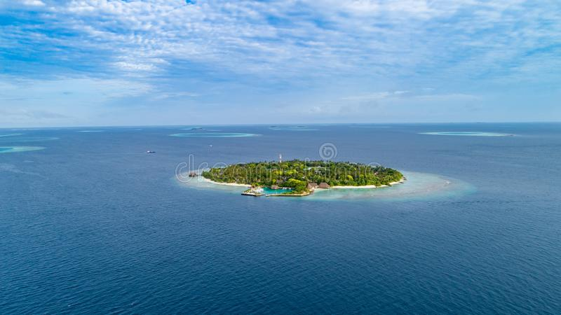 Aerial view of beautiful island at Maldives in the Indian Ocean. Top view from drone.  stock photos