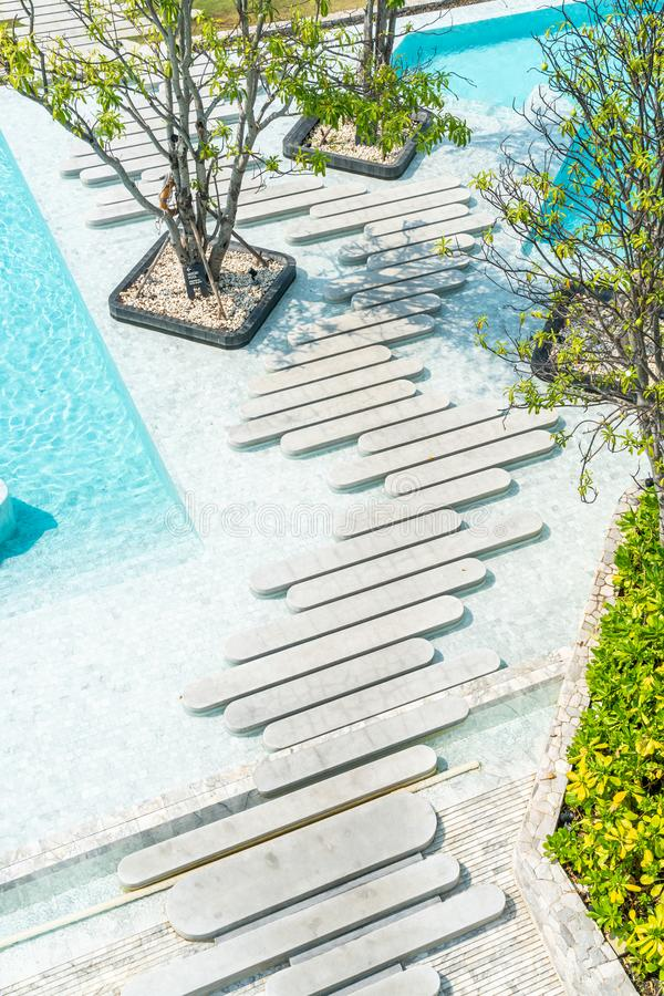 Aerial view of Beautiful luxury hotel swimming pool resort. With walk way stock photos