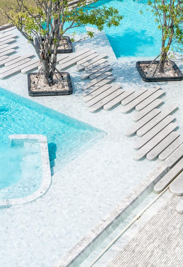 Aerial view of Beautiful luxury hotel swimming pool resort. With walk way royalty free stock photography