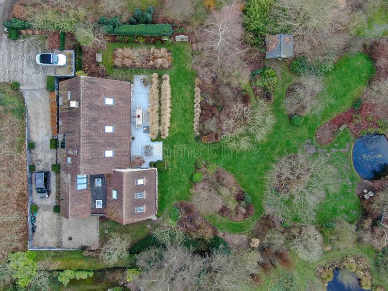 Aerial view of beautiful luxury villa with english garden type during winter season. stock images