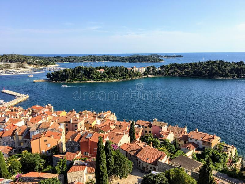An aerial view of the beautiful old town of Rovinj, Croatia on the Istria Peninsula along the Adriatic Sea from the bell tower. In the distance is otok sveta royalty free stock image