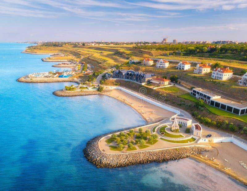 Aerial view of beautiful sandy beach, blue sea, promenade royalty free stock photography